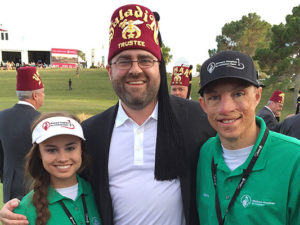 Saladin's Recorder with on the 18th green at the close of the Shriners Hospitals for Children  Open with 2016 National Patient Ambassadors Karolina Nogues and  Marius Woodward  at TPC Sumerlin in Las Vegas, NV.